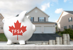 stock-photo-canadian-tax-free-savings-account-concept-with-a-piggy-bank-and-coins-stacks-431834503
